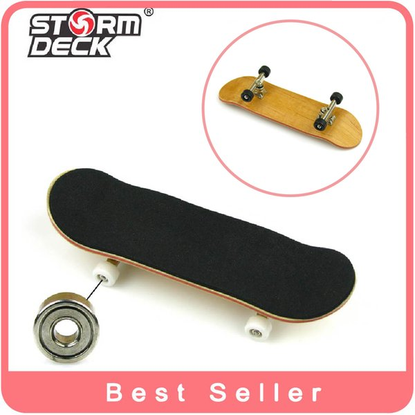 Wholesale-1 Piece With Gadget Professionale in legno di acero Tastiere in lega di nichel stent cuscinetto ruota dito skateboard mini skate toys