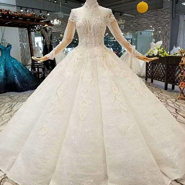 Vestidos de novia de marfil musulmán Longitud del piso Ilusión Cuello alto Tul Manga larga Con cordones Volver Forma de curva Vestido de novia Envío rápido