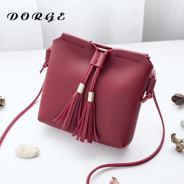 The new fashion lady bucket type tubing Tassel mobile phone bag single shoulder with many summer slant sloping simple pocket wallet