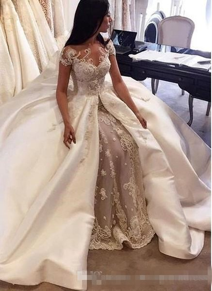Luxury ball gown wedding dre e 2017 audi arabia cap leeve lace applique atin over kirt bridal gown cu tom made dubai wedding dre e