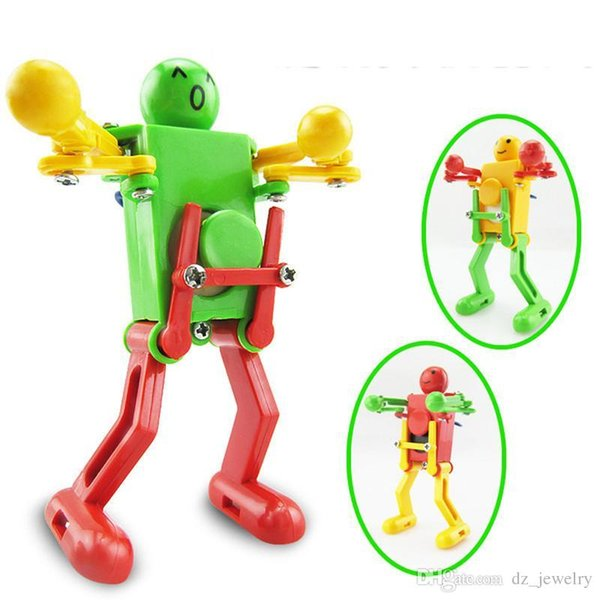 Walking Dancing Robots Toys 360 degrees Clockwork Wind Up Dancing Robot Toy For Baby Kids Developmental Gift Puzzle Christmas New Year Gifts