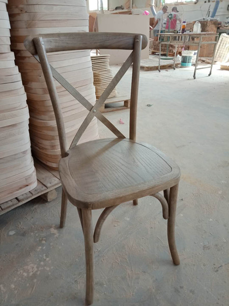 vintage stackable oak wood cross back chairs for catering event