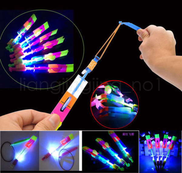 led Amazing flying Light Arrow Rocket Helicopter Flying Toy Party Fun Gift Elastic flshing gow up roket chirstmas toys GGA519 1000PCS