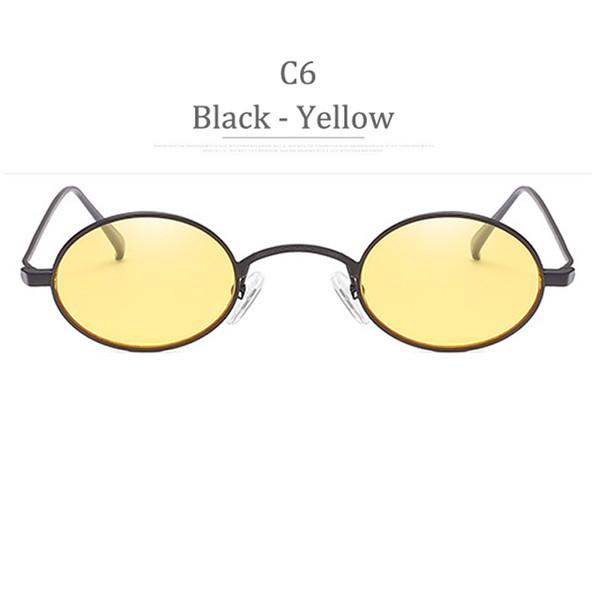 Lente gialla con montatura nera C6