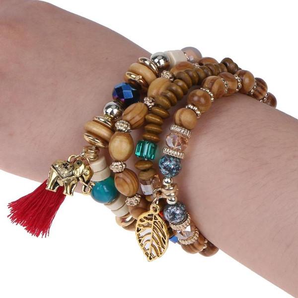 4 teile / satz Multilayer Holz Perlen Quaste und Blatt Charme Schmuck Strang Stretch Boho Yoga Mala Armbänder Armreifen Kette für Frauen
