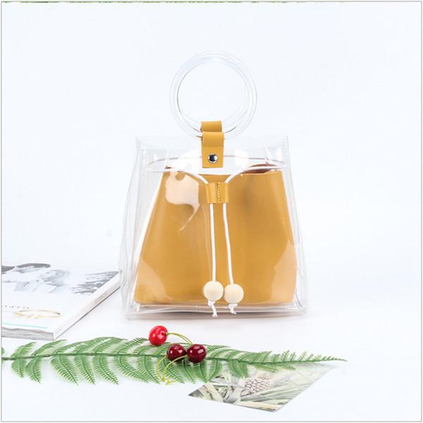 La nuova borsa delle donne dell'estate 2018 fa la borsa delle signore della gelatina trasparente del PVC della piccola di modo semplice piccola.