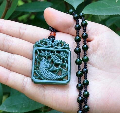 Xinjiang Hetian jade hollow double-sided carved fish jade brand annual pendant pendant men and women necklace rich fish