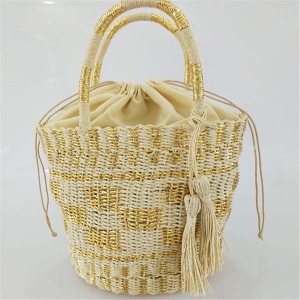 New INS gold and silver bucket woven straw bag handbag shoulder handmade woven bag straw beach ba