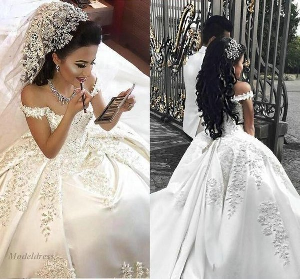 2018 New Arabic Off Shoulder Ball Gown Wedding Dresses Lace Applique Crystal Beaded Satin Long Plus Size Sweep Train Formal Bridal Gowns