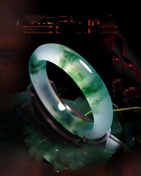 Natural Burma jadeite jade bracelet female ice oil green light green jade jade bracelets with floating flowers .