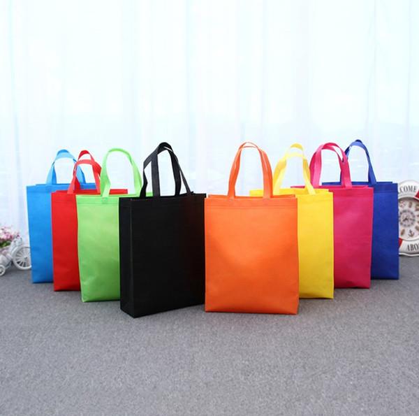 Customize the LOGO Nonwoven fabric Reticule Advertising shopping bags Environmental gift handbag Light Clothing bag Pure color A03