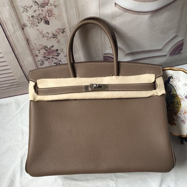 Luxury women leather tote  imported togo leather fine grain non deformable  uper  oft handbag  high co t effective bag