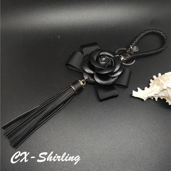 Mezcla de colores de cuero genuino borla llavero titular llavero cadena del coche anillos mujer bolsa coche camelia flor decoración de la joyería regalos