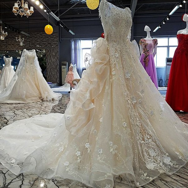 2019 Latest Design Wedding Dresses Tulle Half Sleeve Backless Cascading Ruffles Shining Sequins Crystal Hand Made 3D Flower Bridal Gowns