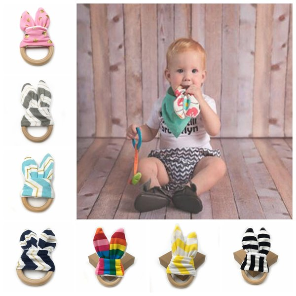 top popular Baby Wooden Teether Training Ring Newborn Toy Eco-Friendly Bunny Ear Wooden Teether Chew Massager Ring DDA473 2020