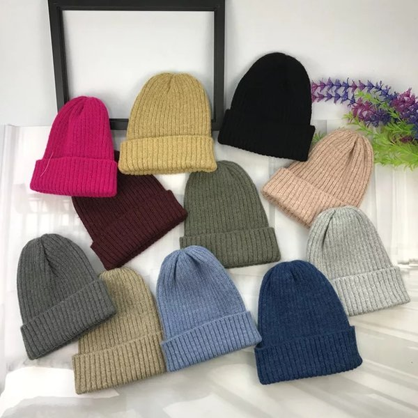 Women's hat autumn winter knitted simple mixed color pointed sweater hat Korean version of the female students warm mohair edge ruffle hat