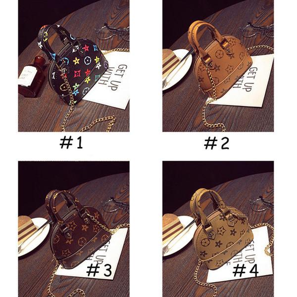 Bolsos de los niños Moda coreana Niños Monederos Niñas pequeños Regalos Bolso de los niños Mini Bolsas de Mensajero Niños PU cuero Shell 0601823