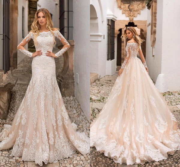 top popular 2019 Gorgeous Champagne Mermaid Wedding Dresses Off Shoulder Lace Appliques Sheer Long Sleeves Tulle Long Bridal Gowns Engagement Dresses 2019