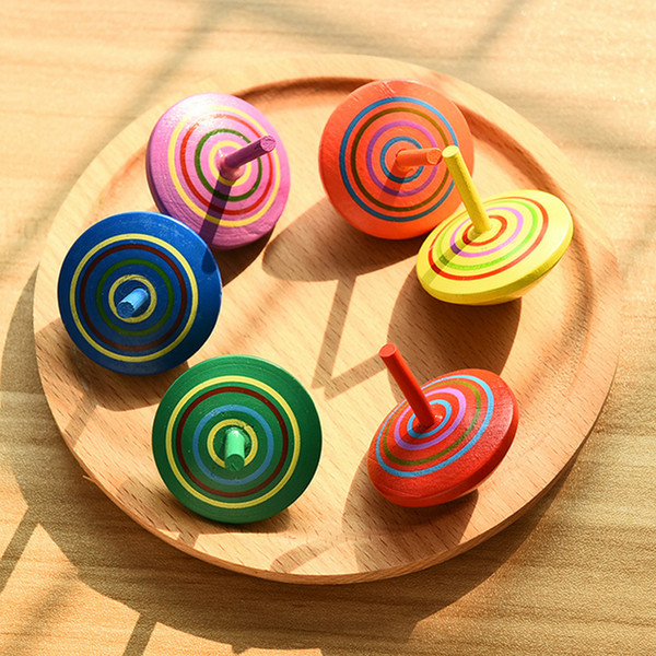 top popular Multicolor Children Wood Toy Mini Wooden Spinning Top Desktop Toy Hand Spinner Learning Educational Novelty Toys Gift for Kids 2021