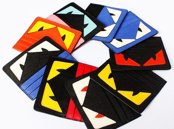 Nueva alta calidad mujeres @ hombres ojos diseñador cero carteras de moda monster card bolsos de estilo corto súper delgado monederos