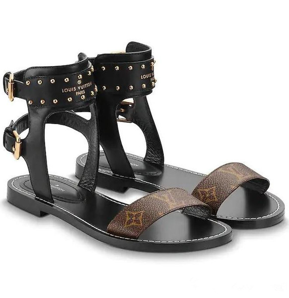 f17713d7d3ea Été Branded Femmes Noir Cuir Nomades Sandales Striking Gladiateur Style  Designer Lady Strap Boucle Ouverte Toe