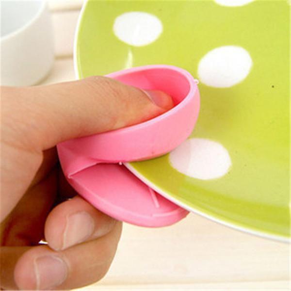Utensilios de cocina Juegos de dedos de aislamiento térmico de silicona dedicados para horno de microondas Juegos simples de pinzas de disco anti-calor