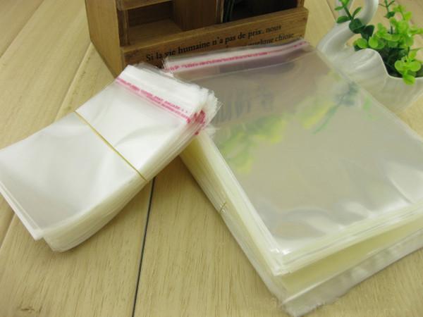 22 * 33 cm, 100 unids / lote - bolsa autoadhesiva del sello OPP, bolsa plástica completamente transparente sellada por el paquete de la joyería / del regalo de la tira del pegamento
