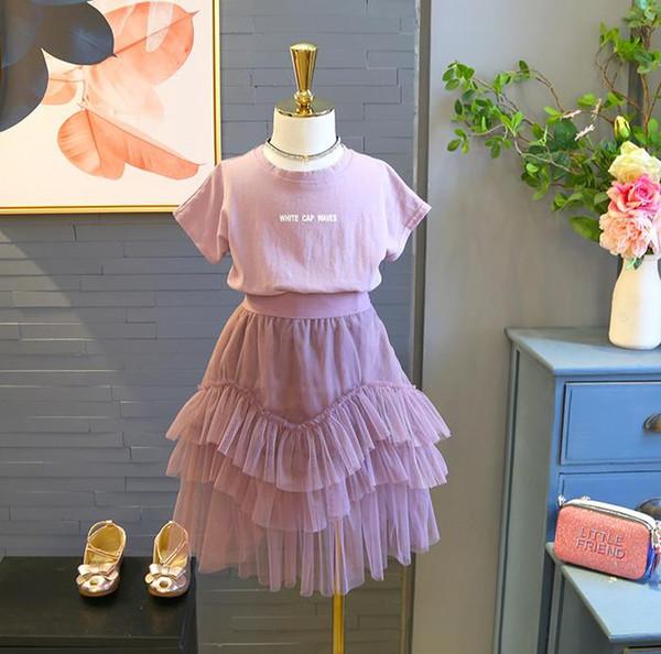 Baby Mädchen kleidet Kleidung Kinderkleidung 2018 Sommer neue Mädchen blass lila Hemd + unregelmäßigen Garnrock zwei Anzüge