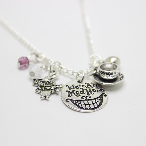 12pcs/lot We're All Mad Here Alice in Wonderland Mad Hatter Hand Stamped charm Pendant Cat Smile Gift Fairytale Jewlery