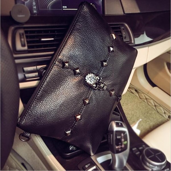 Factory direct brand men bag street trend rivet hand grab bag soft leather diamond hand bag personality ghost head decoration fashion hand w