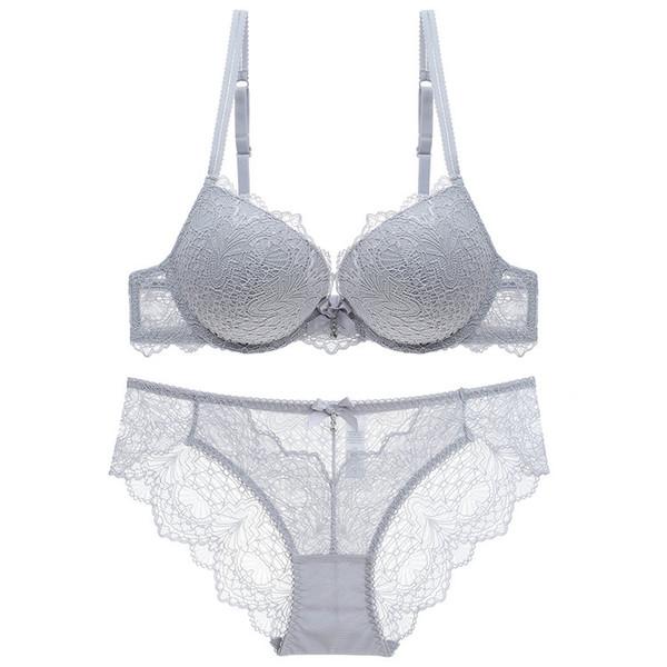 Neuer süßer versammelter Büstenhalter reizvoller transparenter Spitzeschlüpfer für Büstenhaltersatz der Frauen Brustverbesserungspolster-Büstenhalterunterwäsche zweiteilige Frau.