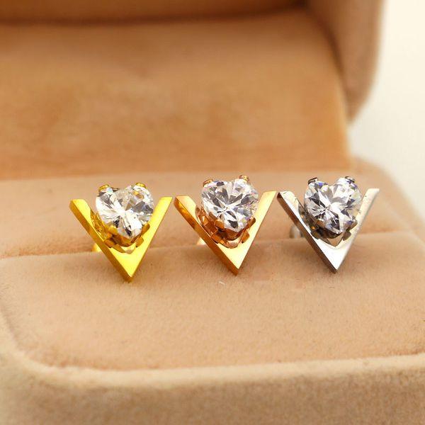 Versión coreana de la nueva letra V corazón de melocotón pendientes de cristal modelos de mujeres Moda de acero titanio en forma de corazón pendientes de pareja joyería