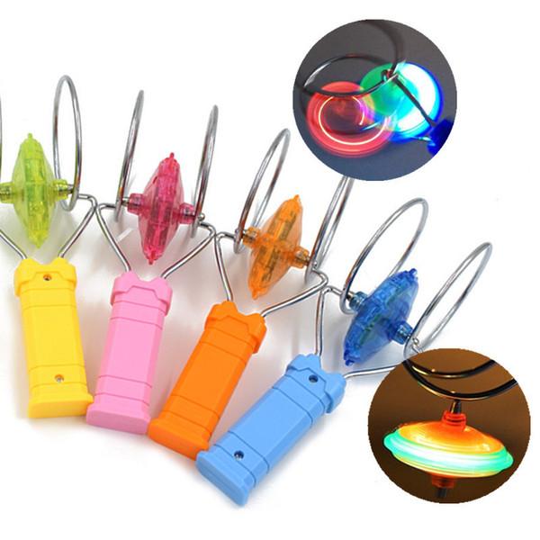 Yanıp sönen Led fidget spinner Üst Manyetik Gyro Tekerlek Parça Oyuncak Sihirli Fantezi Lazer Işık Gyro Bauble Renkli Parlaklık Plastik Çocuk oyuncakları Hediye