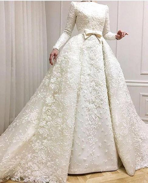Скромные мусульманские свадебные платья 2018 Кружева с длинными рукавами Аппликация из бисера Свадебные платья с Оверски юбки Свадебные платья BA9362