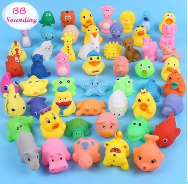 best selling High Quality Baby Bath Water Duck Toy Sounds Mini Yellow Rubber Ducks Bath Small Duck Toy Children Swiming Beach For kids Gifts