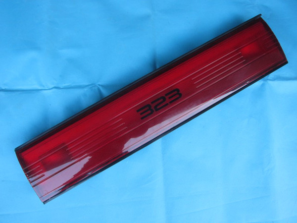 top popular Tail lamp license rear middle center light finisher lens for Mazda 323 BG 1991 1992 216-2903N BB4E-50-850A 2021
