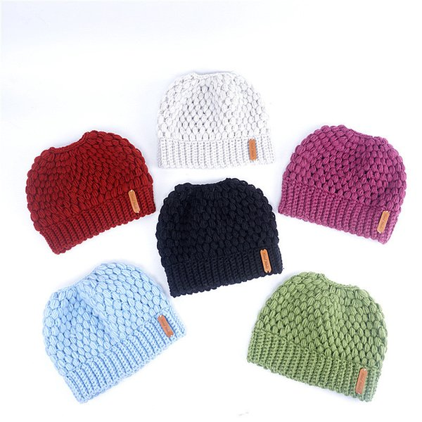 2018 Women Knitted Hat Autumn Winter Warm Ladies Horsetail Caps Hollow Out Hats Beanie Girls Designer Fashion Ponytail Caps