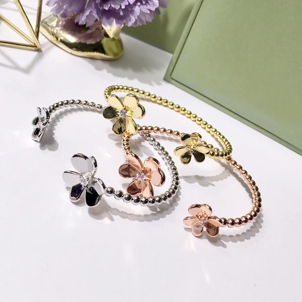 Bracelet en laiton de 5,6 cm avec décor de fleurs et de diamants