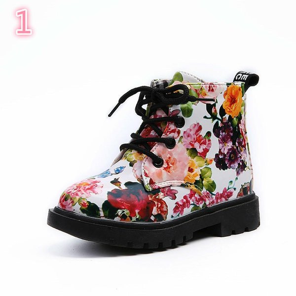 Pair of shoes kids winter and autumn patent leather floral martin waterproof boots rome