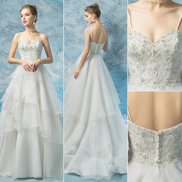 2019 Top quality Beach Wedding Dresses sexy Spaghetti straps crystals beaded empire waist Boho bridal Wedding Gowns Backless Bohemian Bride