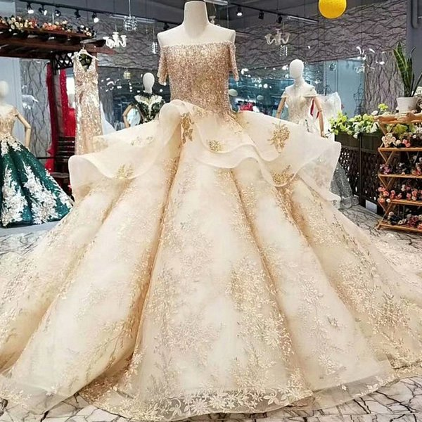 2019 Luxury Golden Lace Shiny Evening Dresses Sexy Off Shoulder Boat Neck Short Sleeves Floor Length Crystal Evening Party Dresses