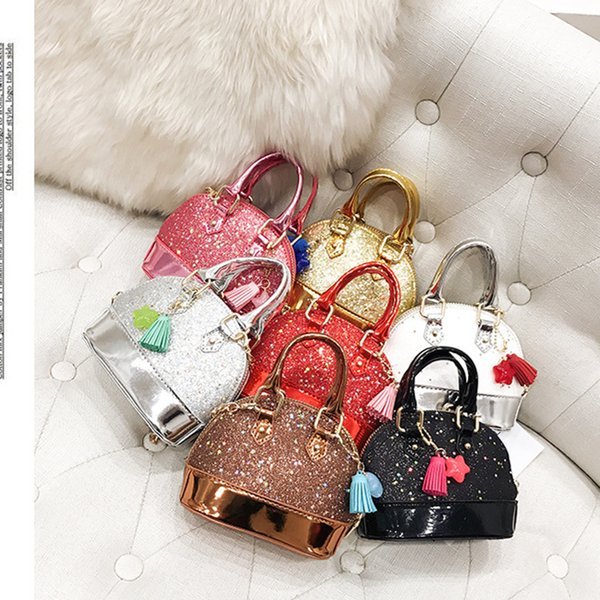 top popular Children Mini Shoulder Bags for Girls Shinning Glitter Purse for Toddler Kids Shell Sequin Bags with Chain Cute Handbags LC789 2019