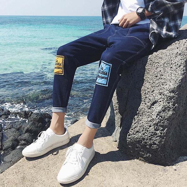L'estate 2018 degli adolescenti casuali della zona di modo dell'estate del denim dei pantaloni di hip-hop del denim dei ragazzi del ragazzo hanno liberato i jeans casuali del harem del joker