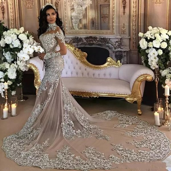 Dubai Arabic Crystal Wedding Dresses Sexy High Neck Beaded Lace Applique Illusion Long Sleeves Wedding Gown Stunning Mermaid Bridal Dress
