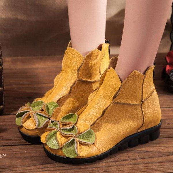 gelbe einzelne Stiefel