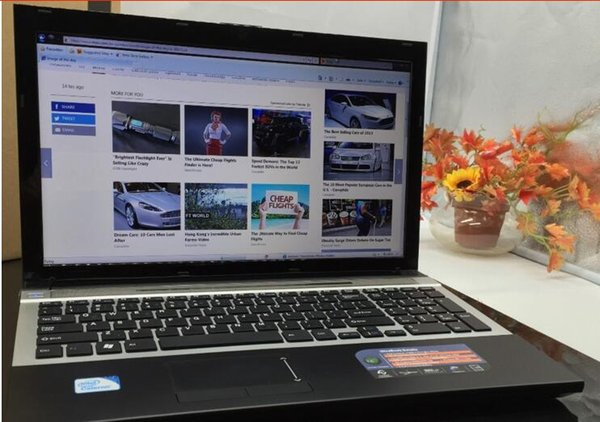 buy one piece laptop netbook 15.6 inch screen size 2gb ram and 320gb hdd Win7 wifi camera