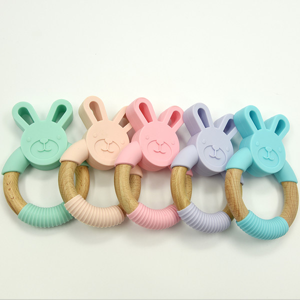 top popular Bunny Silicone and Wood Teether Ring Natural Organic Beech Wood Teething Ring Soft Bunny Rabbit Chew Toys Baby Infant Gifts 2020