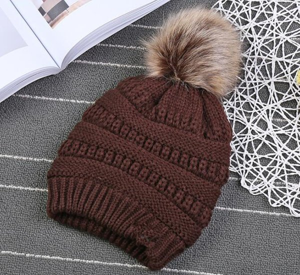best selling Kids pompom Trendy Hats Kids Knitted Fur Poms Beanie Winter Luxury Cable Slouchy Skull Caps Fashion Beanie Outdoor Hats KKA3780