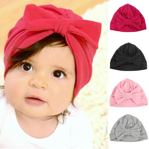 fd67cca96 Cotton Solid Color Baby Girl Hats Baby Photography Props Newborn Children  Bowknot Bonnet Cap Toddler Boy