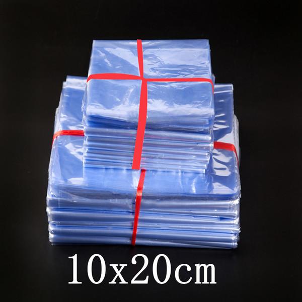10 * 20 cm Borrar PVC Heat Shrink Bag Storage Film Heat Seal Shrinkable Polybag Venta al por menor de plástico regalo Cosmetic Packaging Pouch envío gratis